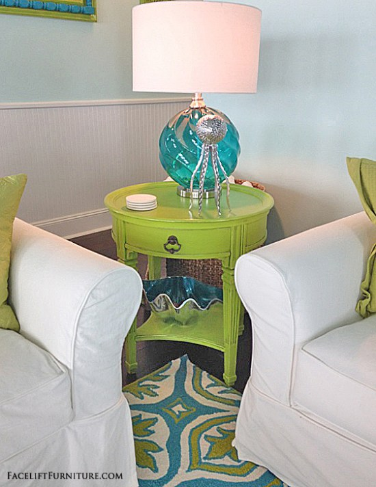 End table makeover in distressed coral with black glaze. From the Beach House collection at Facelift Furniture.