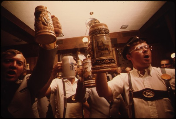 BEER_STEINS_ARE_RAISED_AS_THE_CONCORD_SINGERS_PRACTICE_SINGING_GERMAN_SONGS_IN_NEW_ULM_MINNESOTA._THEY_ARE_TRYING_TO..._-_NARA_-_558266-e1434616632357