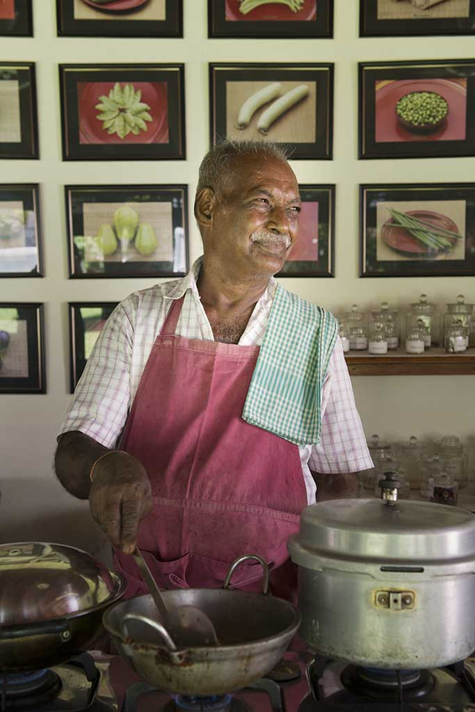 Master Chef Karrupiah of The Bangala Hotel and cooking school in Karaikudi at work on a mutton recipe.
