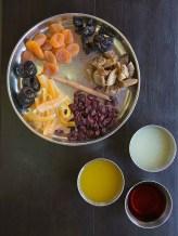 Mis-en-place for fruit compote - apricots, dates, prunes, cranberries, candied orange peel, cinnamon stick, orange juice, lime juice, rum. The Bangala, Karaikudi, Chettinad.