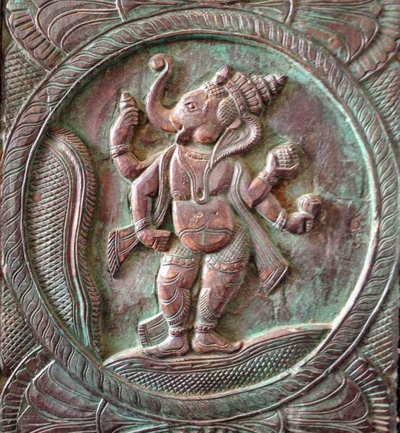 Interior detail of a copper relief with a gently turquoise patina, features four-armed Ganesh, Meenakshi Amman Temple, Madurai.