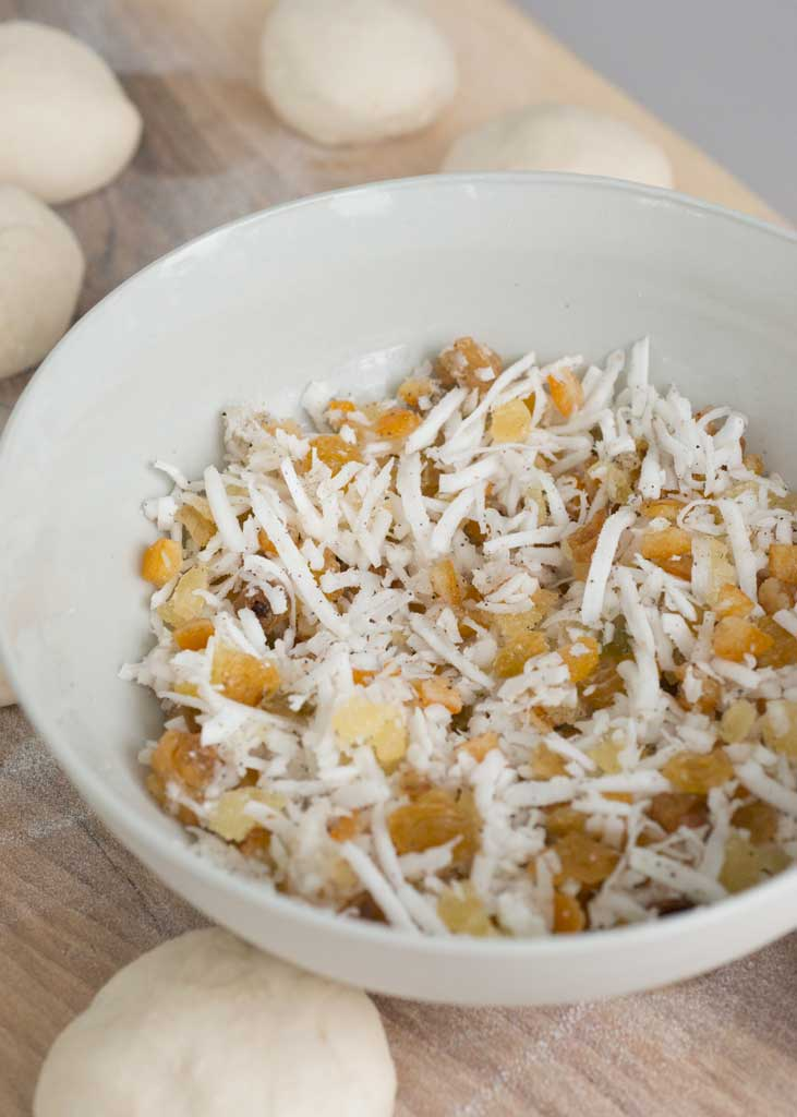 Shredded coconut, candied ginger and citrus peel filling for buns.