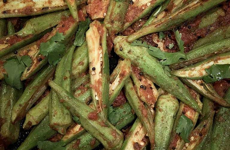 Okra sliced lengthwise is prepared into a red curry.
