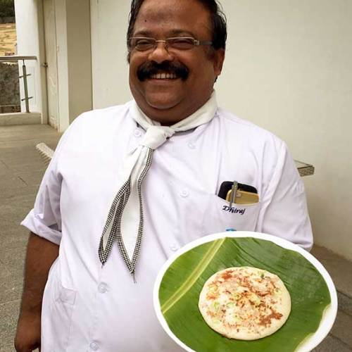Chef Dhiraj ready to serve utappam.