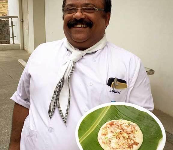 Chef Dhiraj ready to serve utappam.