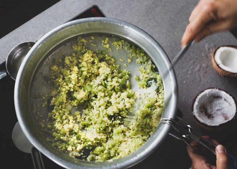 Preparation of green bean thoran.