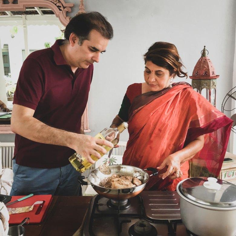 Sumeet with Anita wearing a burnt orange sari making poulet