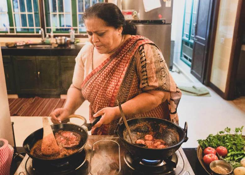 Abida Rasheed prepares fish.