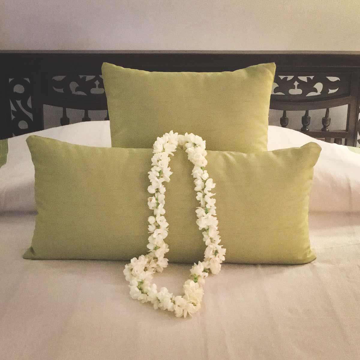 white flower garland on a pillow