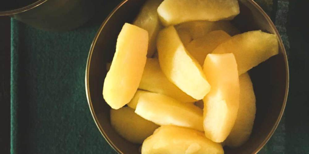 Steamed apple segments in a bowl