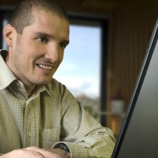 Image of a man at a computer
