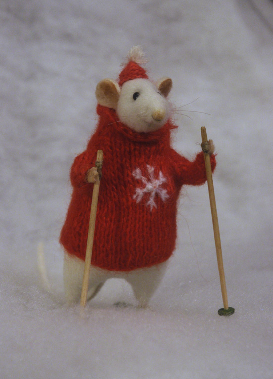 skiing stuffed rat in a red holiday sweater & hat