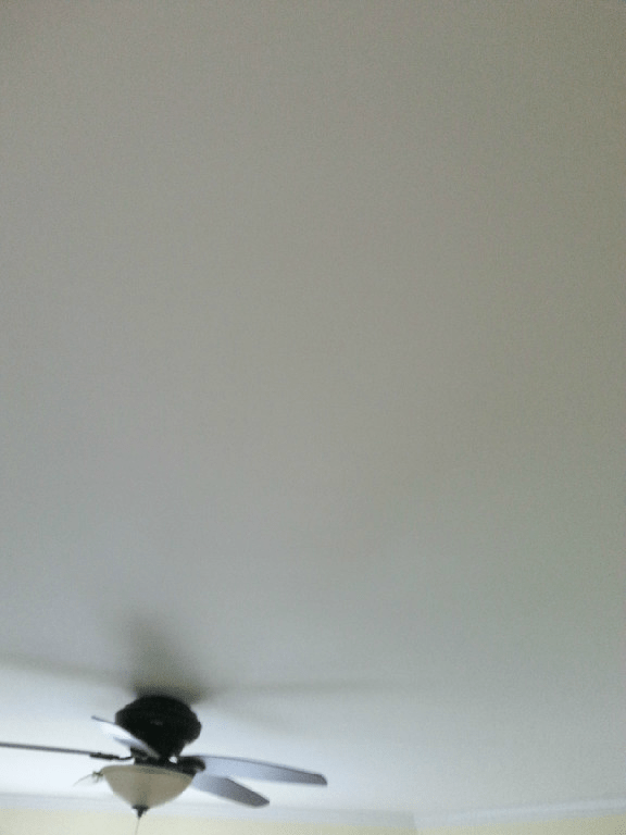 perfect drywall ceiling with no evidence of a large hole that was cut in it