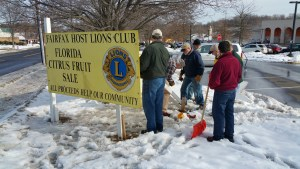 Fairfax Lions prepare signs advertising the March Sale