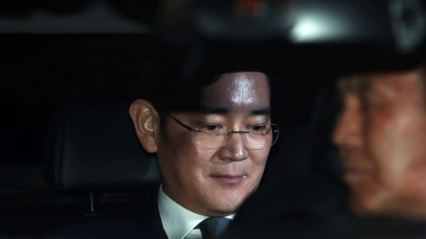 Jay Y. Lee pictured at the time of his arrest in Seoul on February 16.