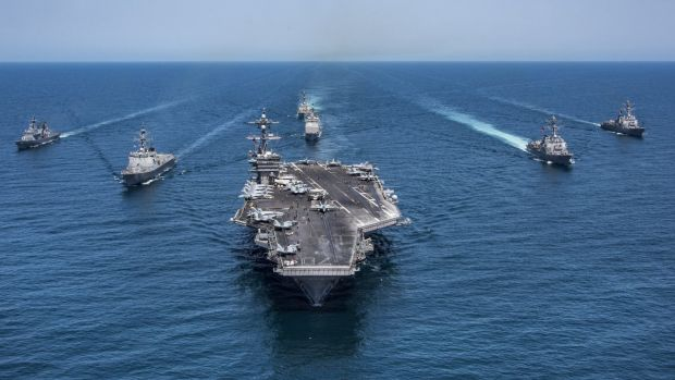 The aircraft carrier USS Carl Vinson, flanked by South Korean destroyers, with the USS Stethem, at the rear in May.