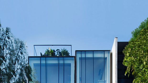 Builder Matt Gibson's home/office in St Kilda is a series of stacked glass boxes.