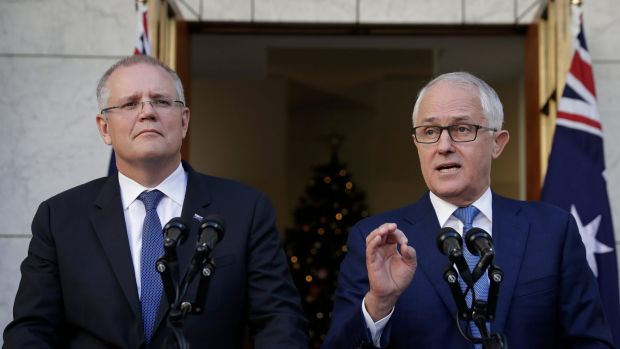 Treasurer Scott Morrison and Prime Minister Malcolm Turnbull: don't celebrate their tax cut promises too soon.