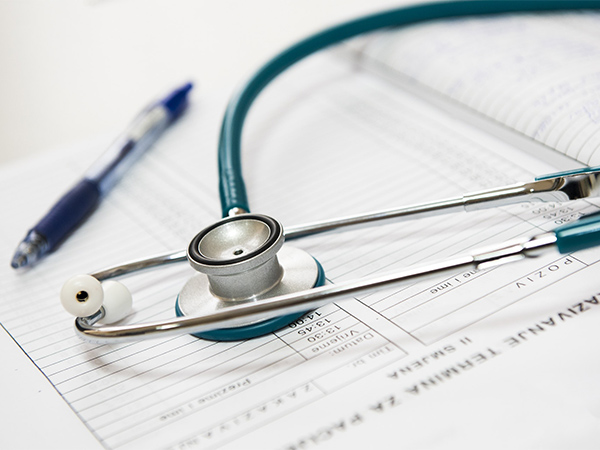 Clinical Negligence, Shows a Stethoscope on top of paperwork