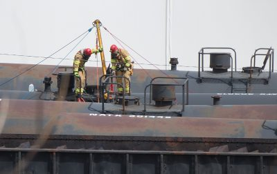 Firefighters on top of a railcar at the scene of the explosion. (Rebecca S. Gratz/The Omaha World-Herald)