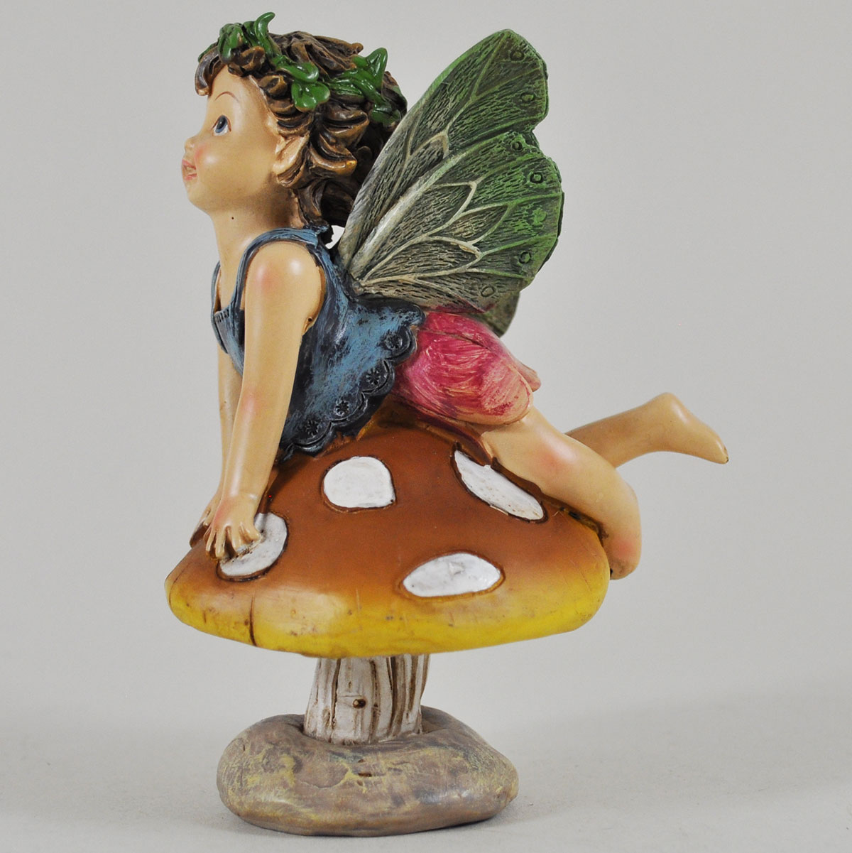 Flower Fairies sitting on mushroomfairygardensukcouk