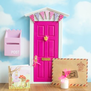 Bright pink Fairy Door with bunting