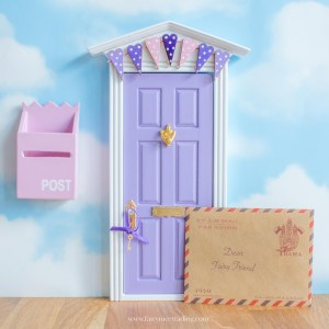 purple fairy door with bunting UK