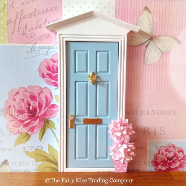 Blue Fairy Door with pink flowerpot