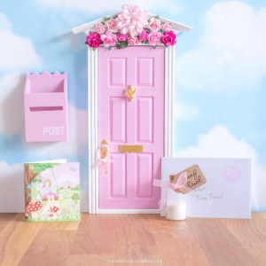 pink fairy door with flower wall uk