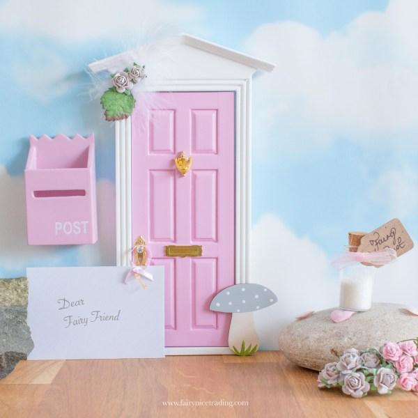 grey and pink fairy door