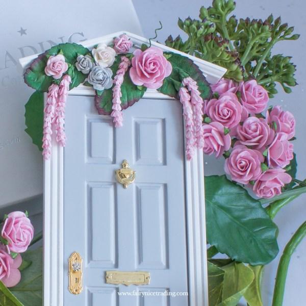 grey fairy door with flowers