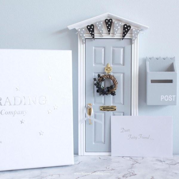 grey fairy door with bunting