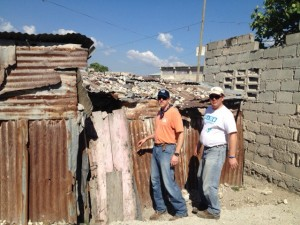 Kevin King and Marc Funk entering a typical home in Citi de Soleil, Haiti