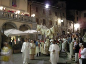 The bishop carrying the Eucharist enters Assisi's main square.
