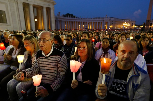Catholics from around the world joined Pope Francis in a candle-light Vigil Prayer Service at St. Peter's Square on the eve of the 2014 Synod of Bishops.