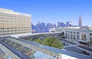 The Hilton Hotel and its sky bridge to Newark Penn Station: the Manhattan skyline is in the distance.