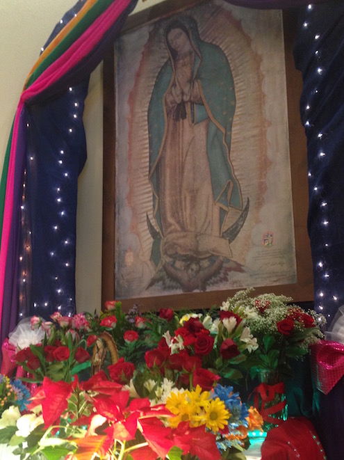 Created for the prayer service, the shrine of our Lady of Guadalupe overflows with flowers presented by the congregation.