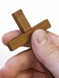 It was a gift when a women in her late fifties spotted a little wooden cross under the glass counter