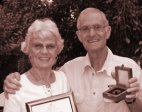Peter Steyn, awarded South Africa's highest award for ornithology, with his wife, Jenny