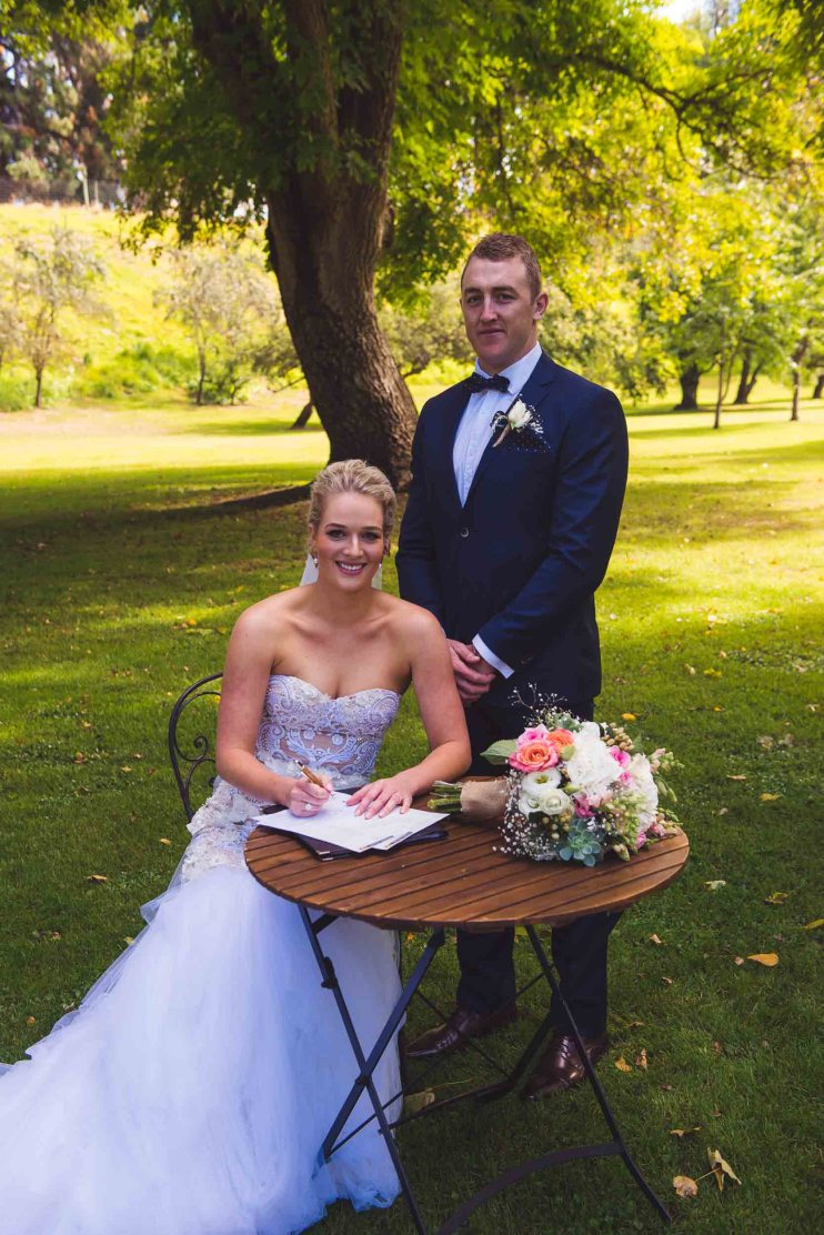 Thurlby Domain ruins wedding ceremony bride groom signing marriage license