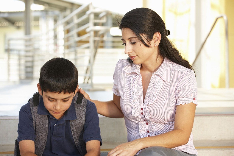 adult comforting child with trauma