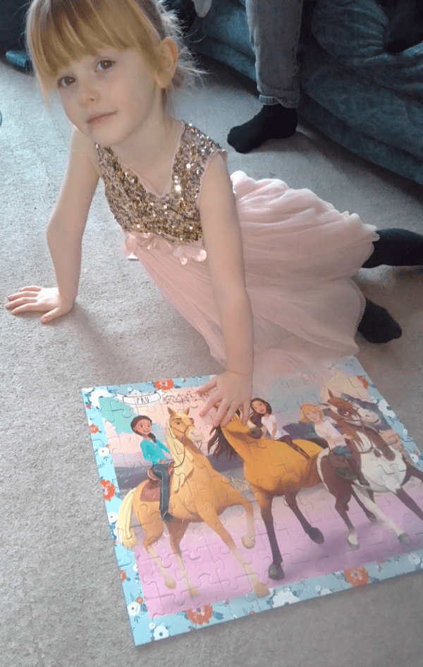 spirit riding free ravensburger 100pc puzzle review by Family Clan 5