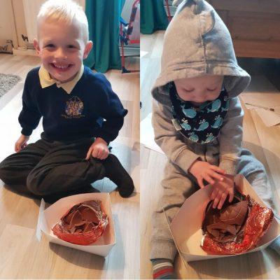 Logan & Jensen eating the 2019 Easter Eggs Family Clan