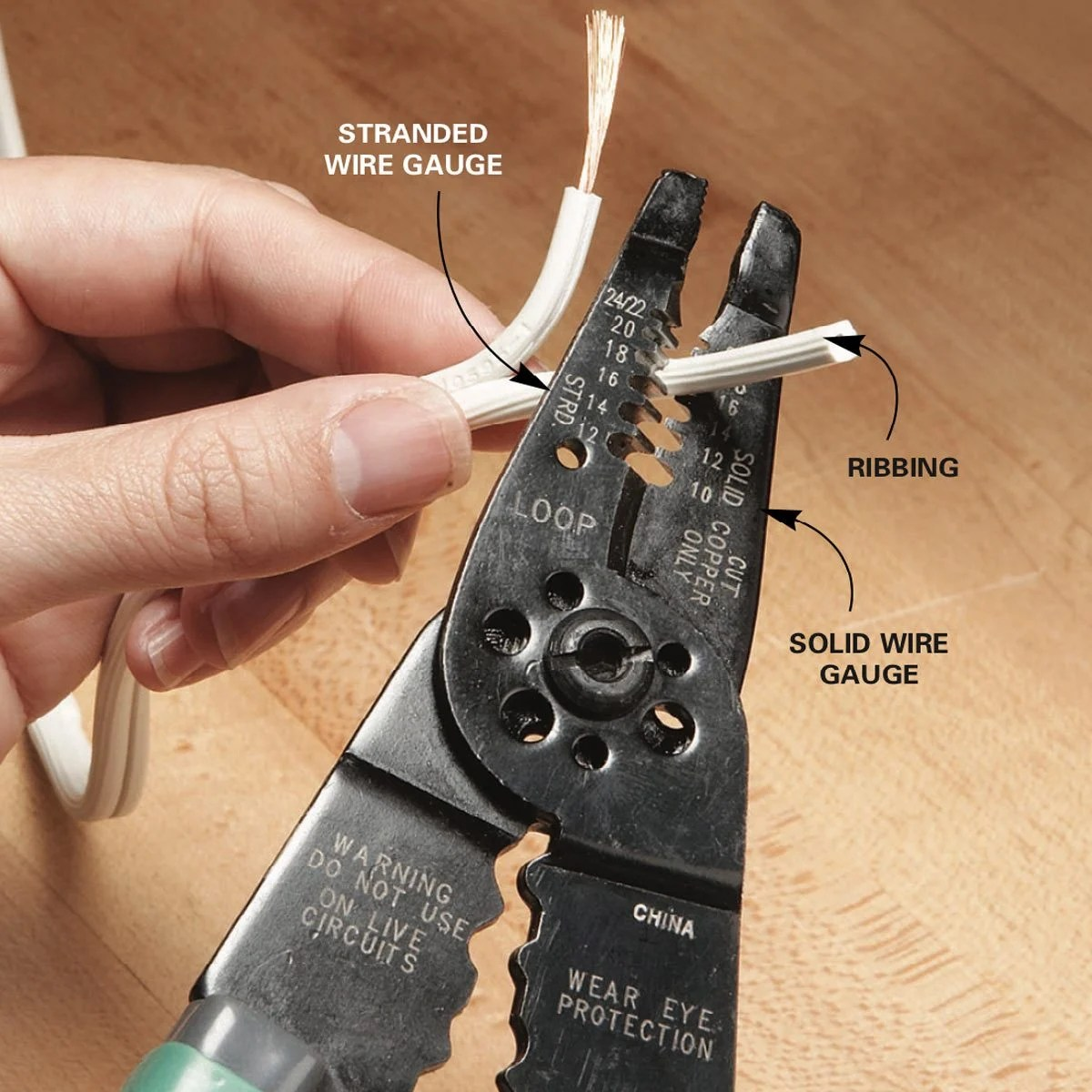 hight resolution of strip the insulation off the wire by cutting and pulling the wire through the wire stripper to prepare the cut end for a new plug cut or pull the two