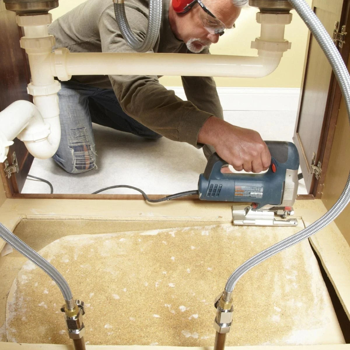 to replace a sink base cabinet floor