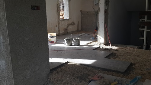 dining area with floor being laid