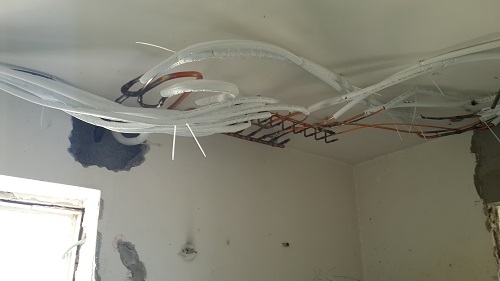 In the bathroom, the ceiling was dropped so to include the main air-conditioning manifold