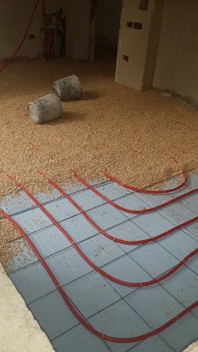 protecting the underfloor heating plus providing a medium to spread the heat evenly on to the tiles above.