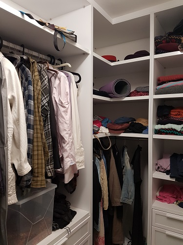 The walk in clothes closet