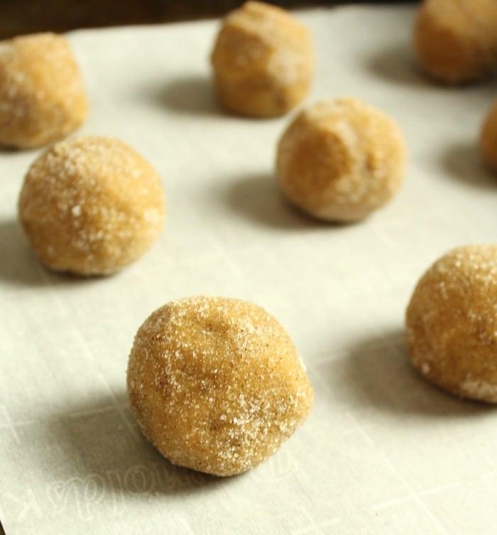 Unbaked dough balls on a baking sheet